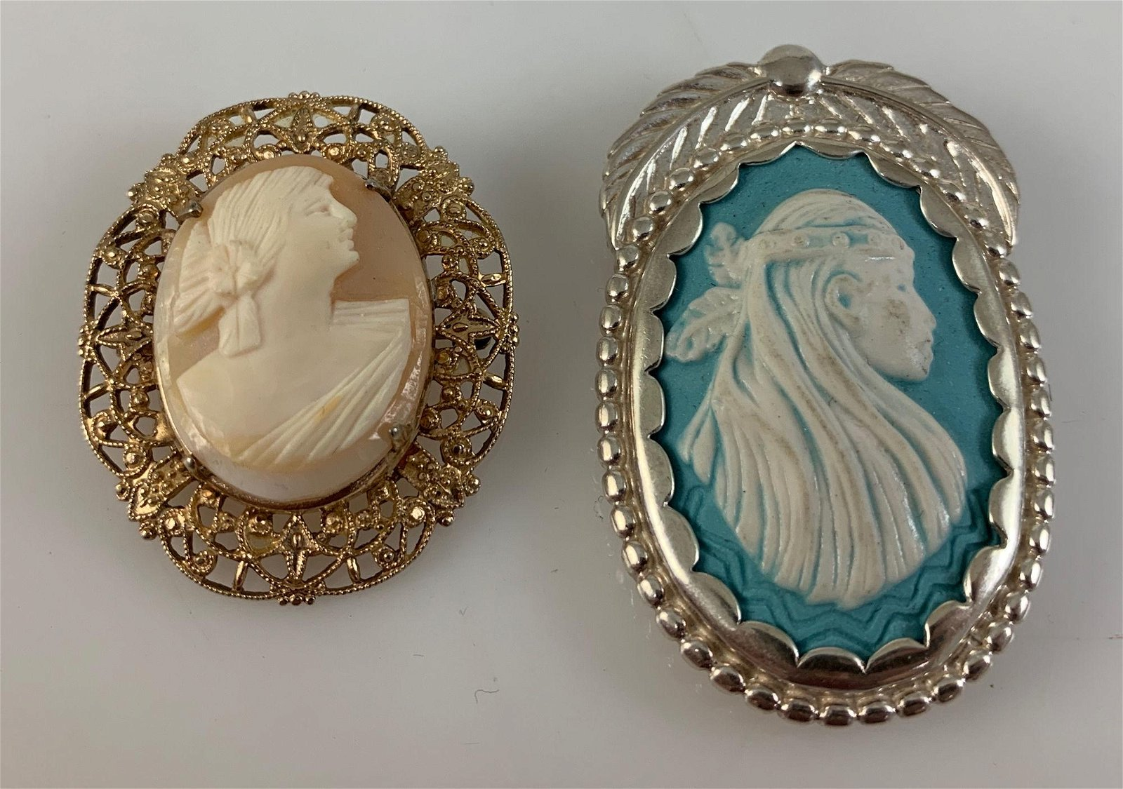 TWO CAMEO STYLE ACCESSORIES