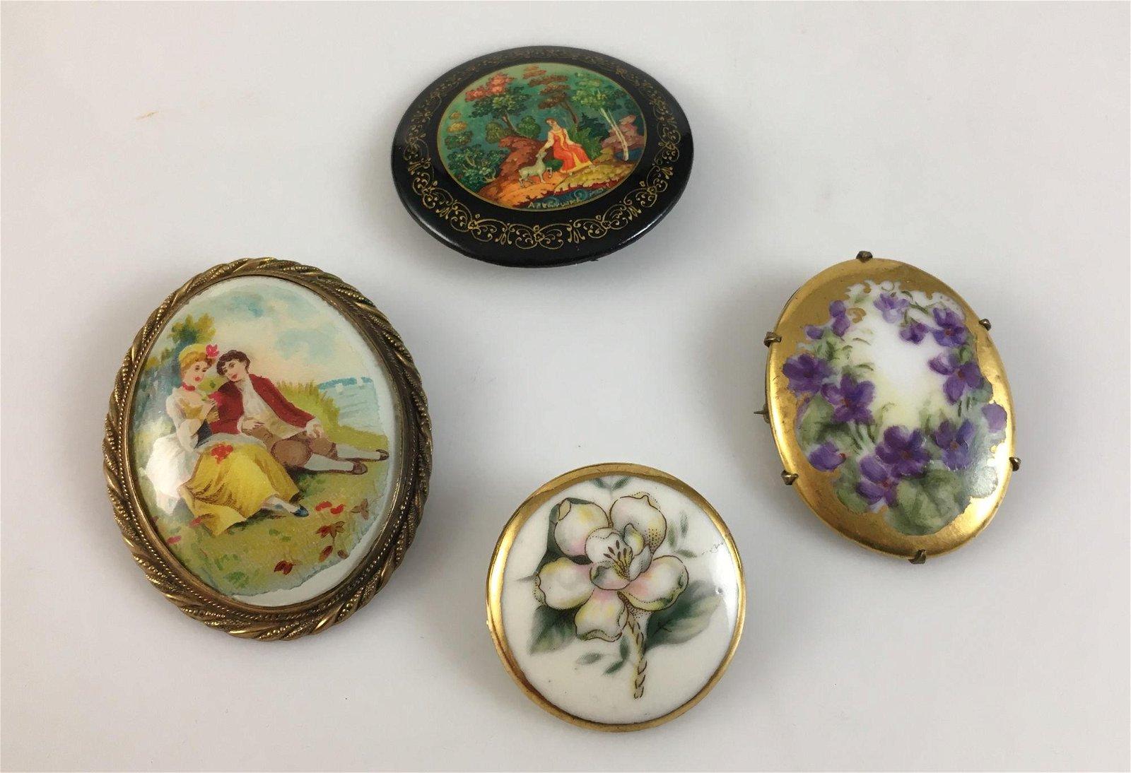 FOUR VINTAGE PINS
