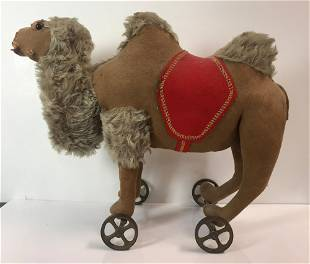 EARLY STEIFF CAMEL PULL TOY. BROWN FELT WITH LONG CURLY