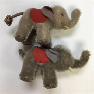 (2) STEIFF MINIATURE GREY MOHAIR ELEPHANTS. UNJOINTED,