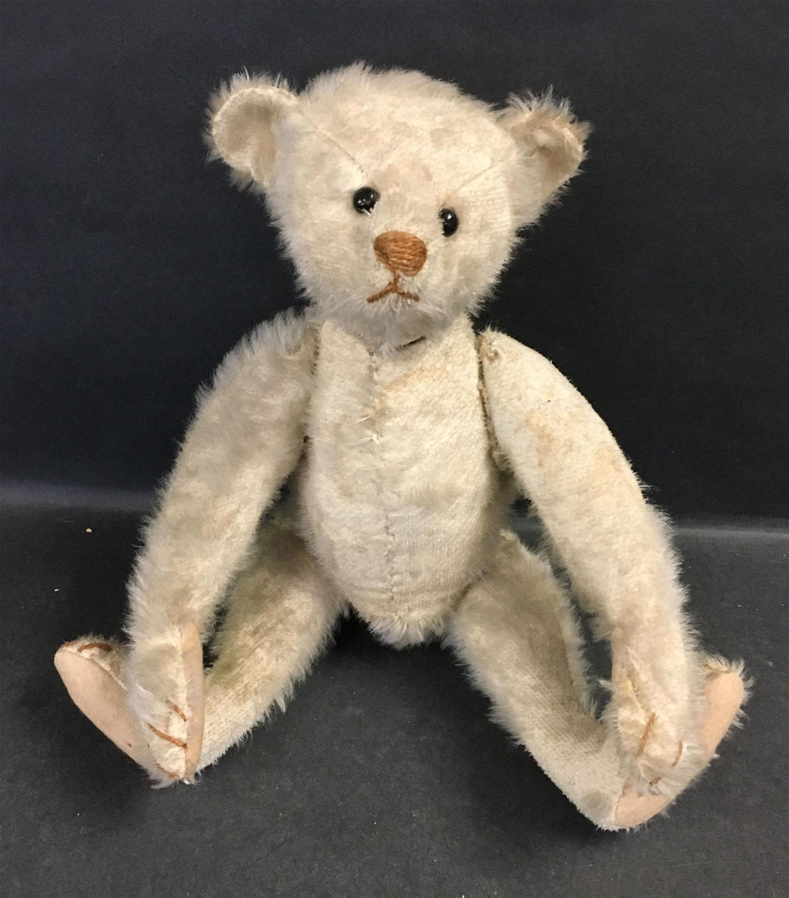 EARLY STEIFF WHITE MOHAIR TEDDY BEAR. DISK JOINTED AT