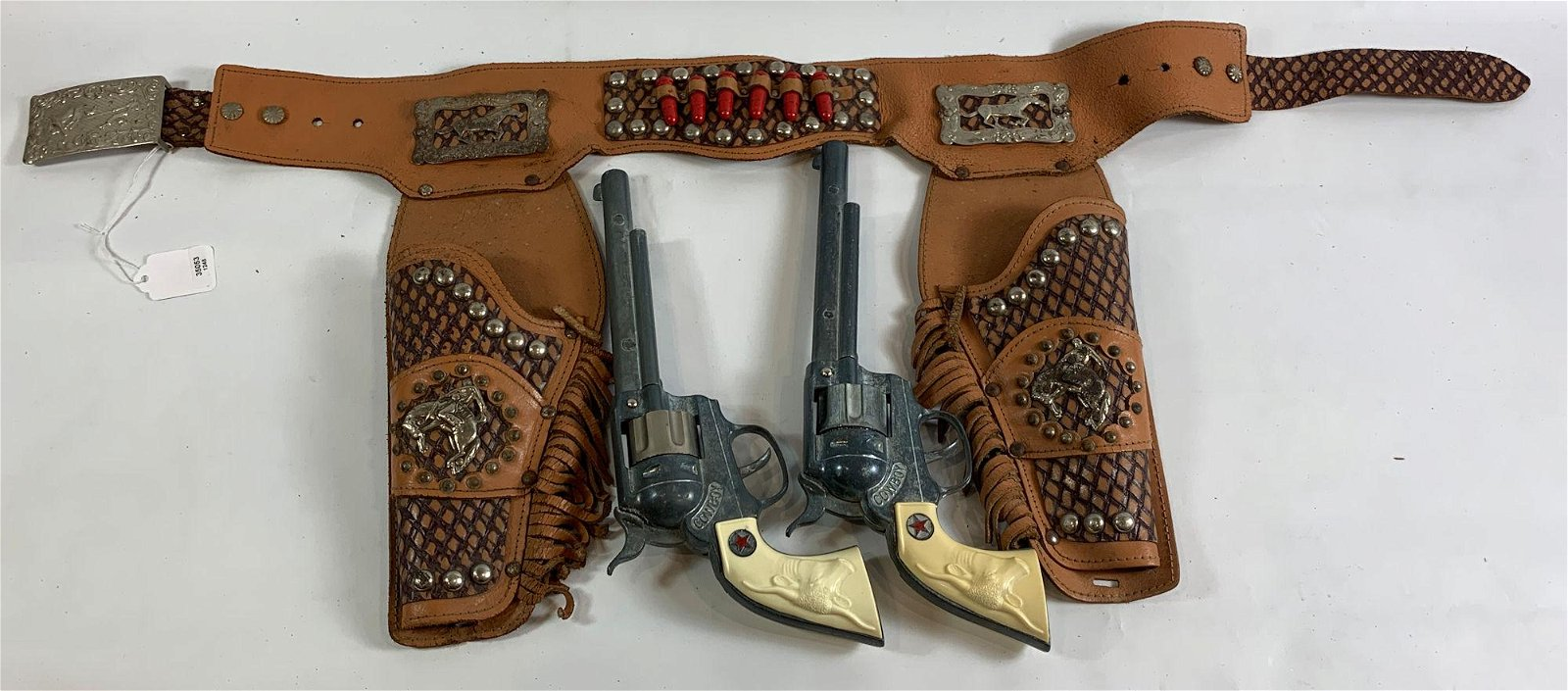 BROWN LEATHER DOUBLE HOLSTER SET WITH RED BULLETS,