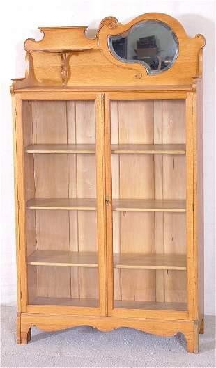 OAK 2 DOOR BOOKCASE W/SHAPED BEVELED MIRROR & ADJ