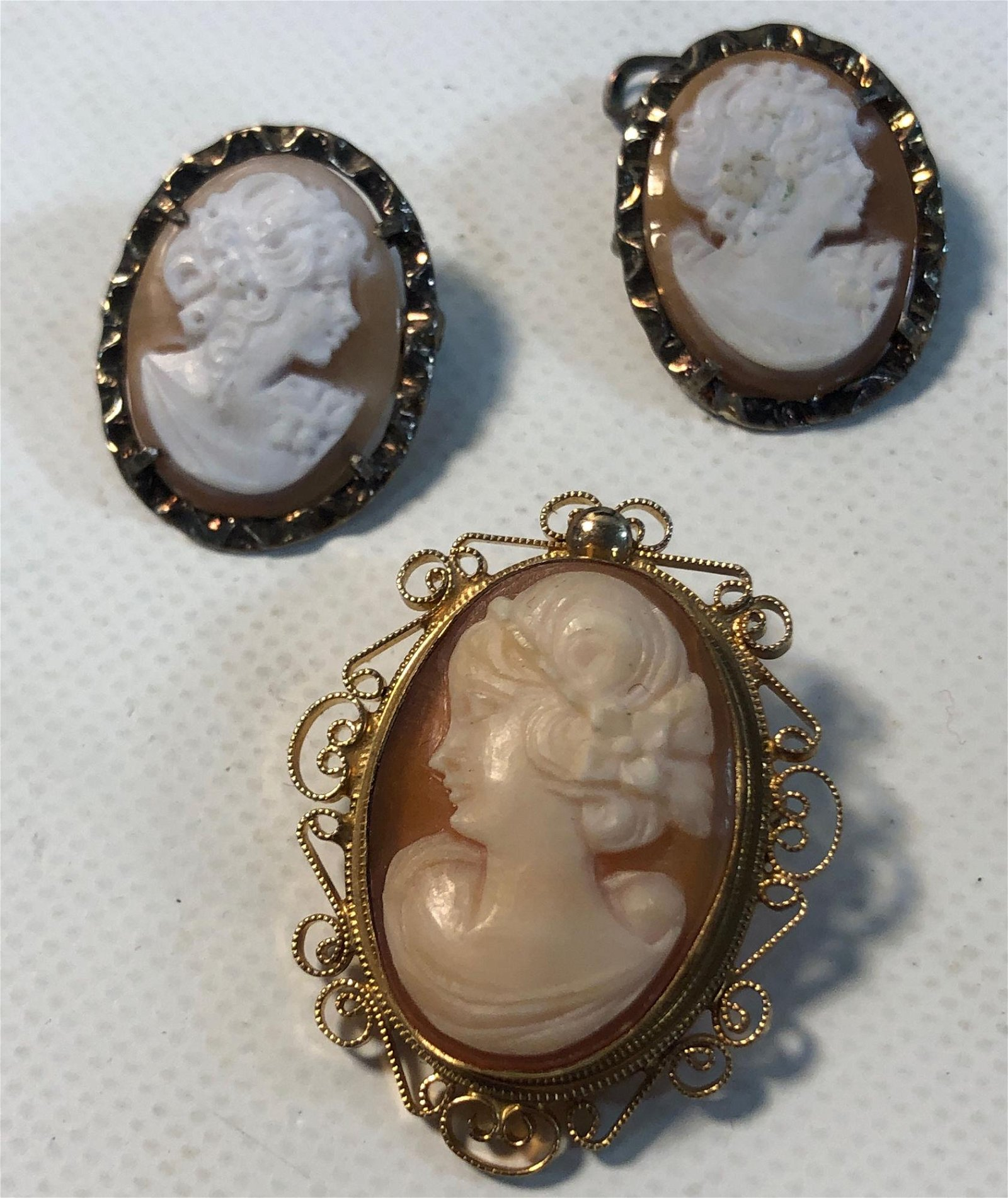 THREE HAND-CARVED SHELL CAMEO PENDANTS