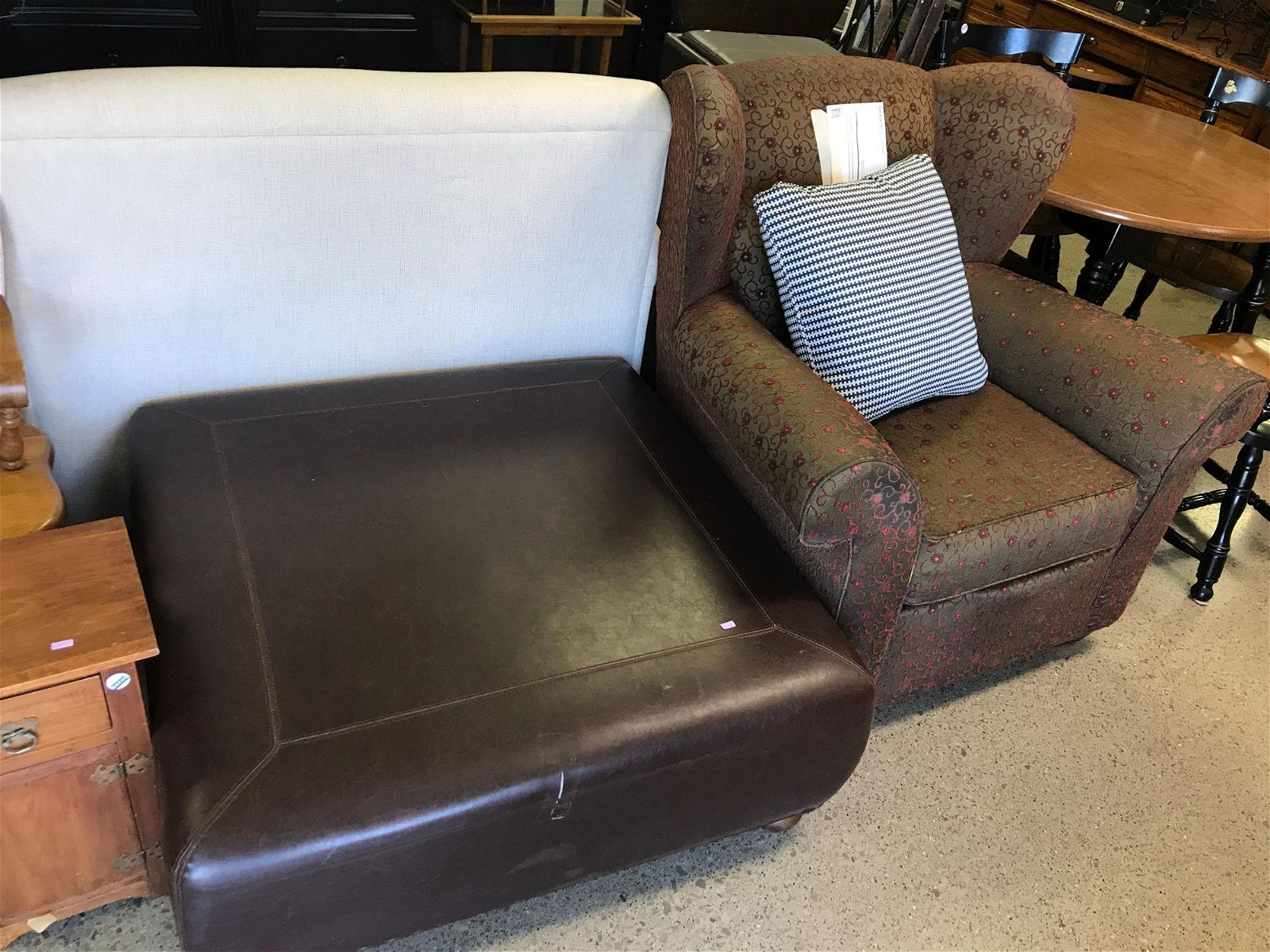 LEATHER OTTOMAN AND SOFA CHAIR WITH FLORAL MOTIF