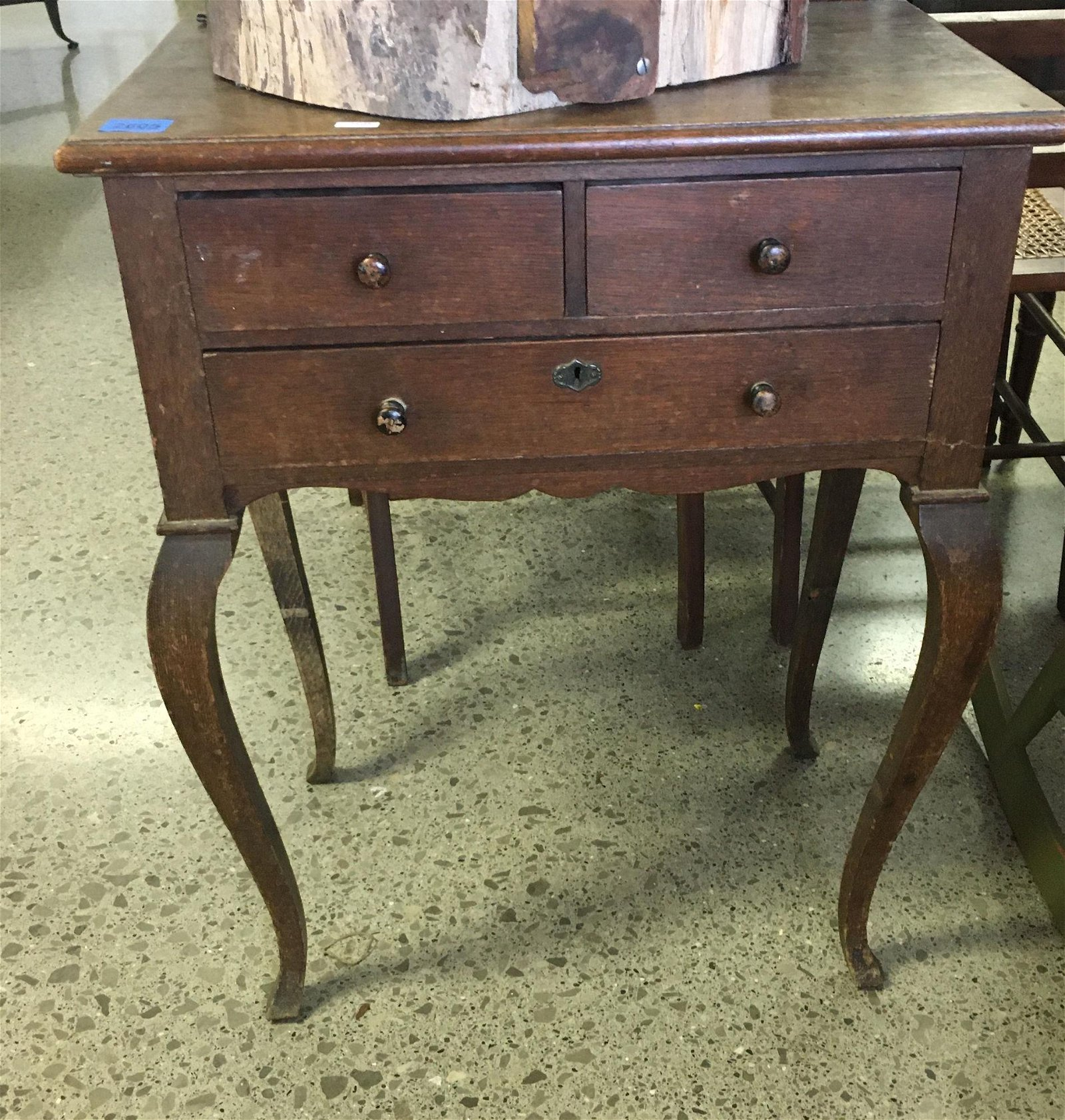 EARLY 20TH CENTURY OAK THREE DRAWER STAND WITH CABRIOLE
