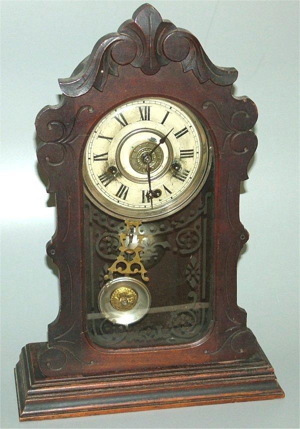 "15016: WALNUT EASTLAKE VICTORIAN MANTEL CLOCK, 11 1/2""W"