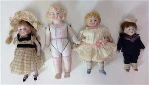 (4) GERMAN ALL BISQUE DOLLS WITH PAINTED EYES INCLUDING
