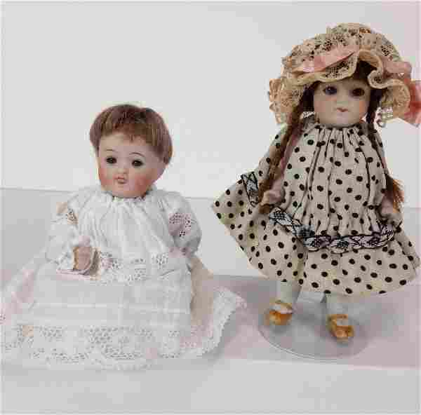 (2) SMALL GERMAN ALL BISQUE DOLLS. MOHAIR WIGS, SLEEP