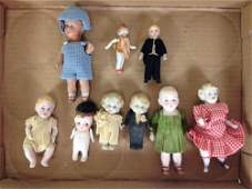 LOT OF (9) SMALL ALL BISQUE DOLLS WITH PAINTED EYES AND