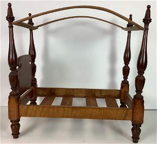Antique four poster doll bed. Constructed of tiger