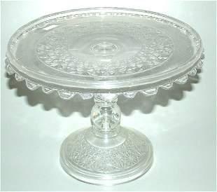 "PATTERN GLASS CAKE SALVER 7 1/2""H X 10""DIAM"