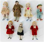 (7) small German all bisque dollhouse dolls; dressed.