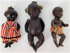 (3) small black baby dolls with painted eyes and