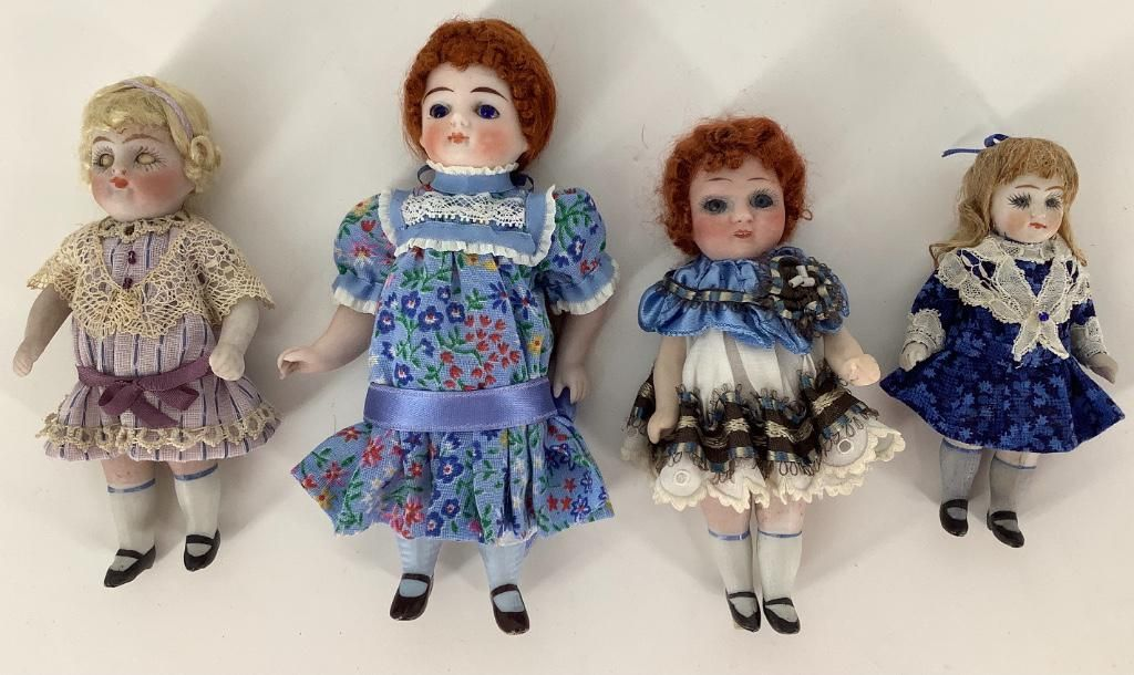(4) small German all-bisque dolls. All have been nicely