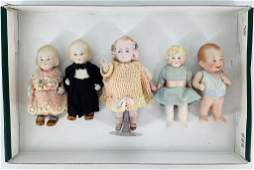 (5) German all bisque dolls with molded and painted