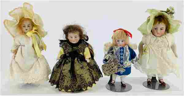 (4) small German all bisque dolls with wigs and molded