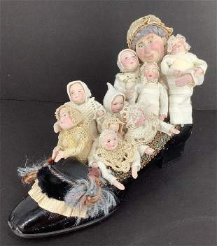 Shoe with Artist made paper clay lady and 9 children