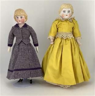 "(2) blonde china shoulder head girls. Includes 14 1/2"""