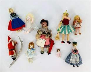 Lot of (8) cloth and painted wood miniature dolls. (1)