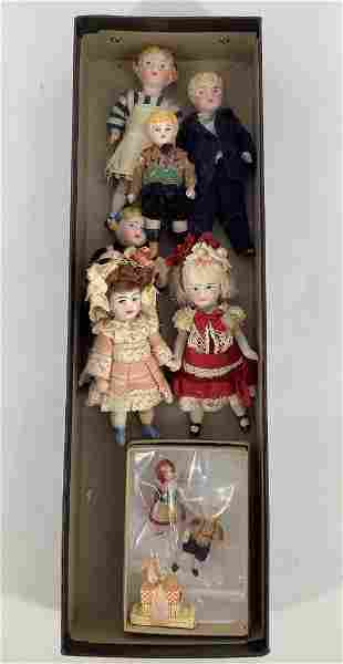 Lot of bisque and china head miniature dolls.