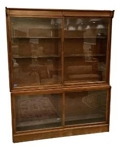 Oak four door stove display cabinet with sliding glass