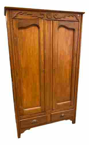 Mixed wood wardrobe with two doors and carved pulls,