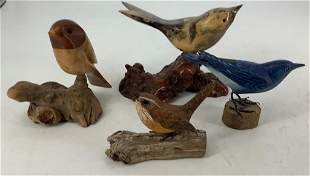 Four carved wooden birds, stained, hand painted, one is