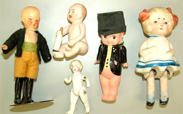 "3614: LOT (4) BISQUE & (1) CELLULOID FIGURES 2 1/4"" TO"