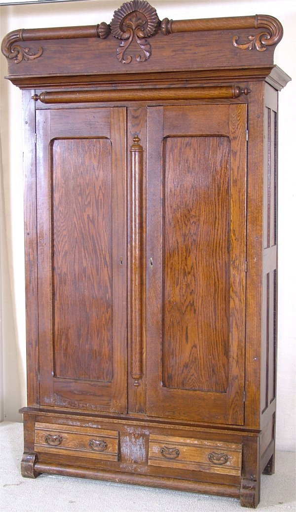 "5120: LRG OAK 2 DOOR WARDROBE W/HEAVY CARVED CREST 50""L"