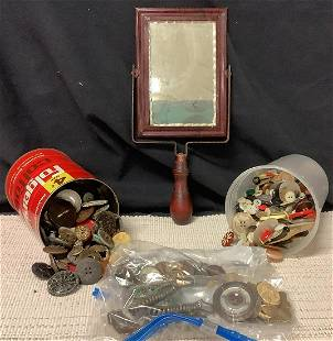 Lot of various buttons and a hand held mirror.