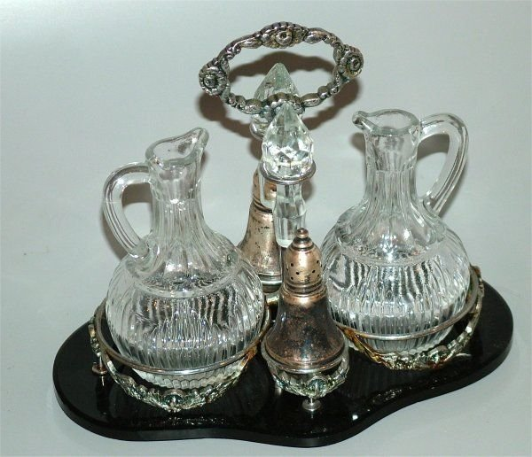 5013A: SILVER PLATE  AND GLASS CASTOR SET