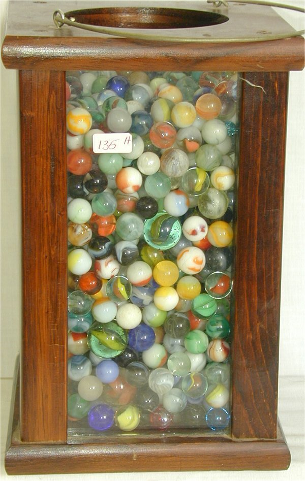 135H: LOT MARBLES & CANDLE LANTERN