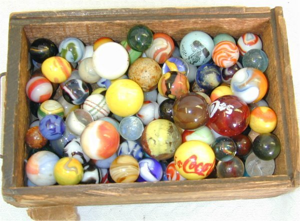 135J: LOT HAND & MACHINE MADE MARBLES IN WOOD