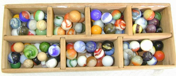 135K: LOT HAND & MACHINE MADE MARBLES IN WOOD