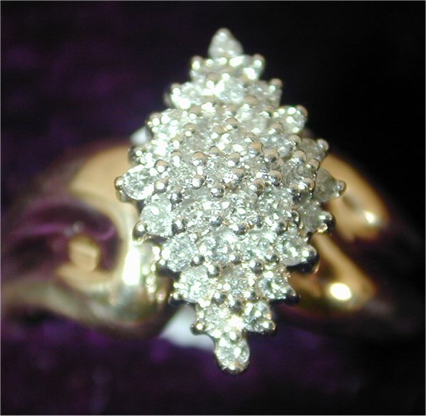 1404: 10K Y G DIAMOND FASHION RING W/36 DIAMO