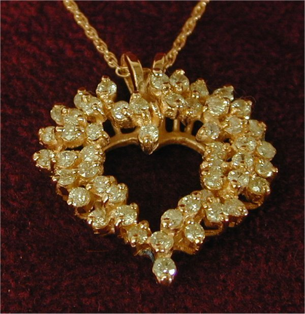 1416: 14K Y G 1 CT TW DIAMOND HEART PENDANT,
