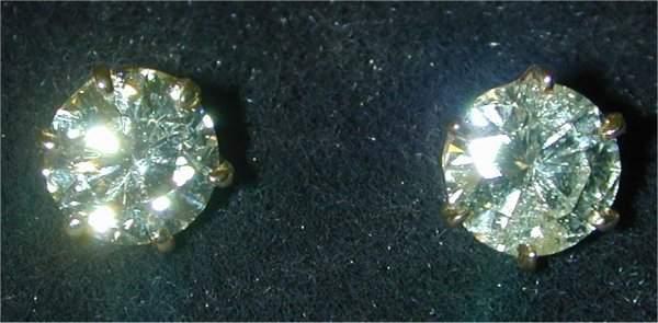 1422: 14K Y G 3.21 CT TW RND DIAMOND STUD EAR