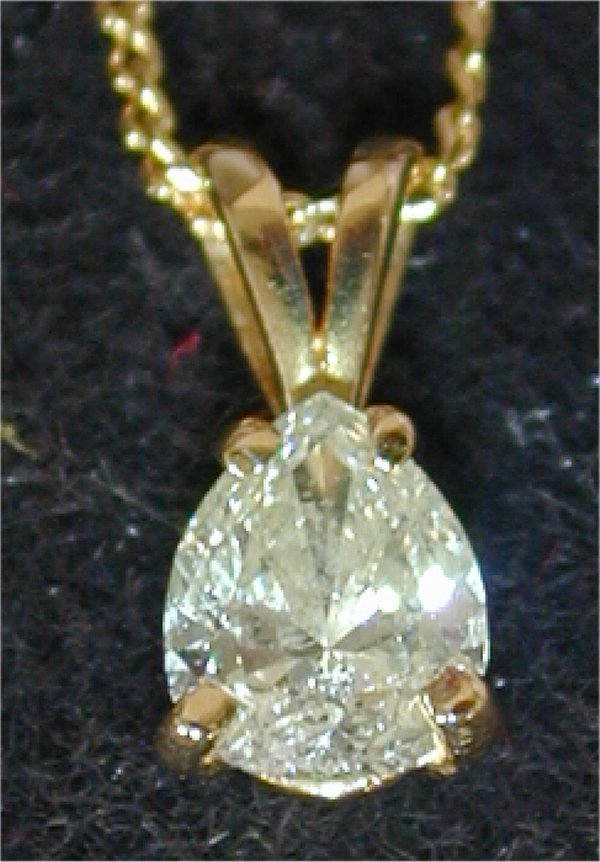 1423: 14K Y G .46 PT PEAR SHAPED DIAMOND PEND