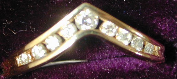 "1424: 14K Y G .30 CT TW ""V"" RING W/9 DIAMONDS"