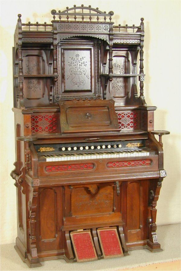 5510: WALNUT VICTORIAN PARLOR ORGAN W/FANCY CARVED BOOK