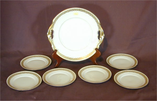 5001: 7 PC LIMOGES DESSERT SET, CHIP ON PLATE