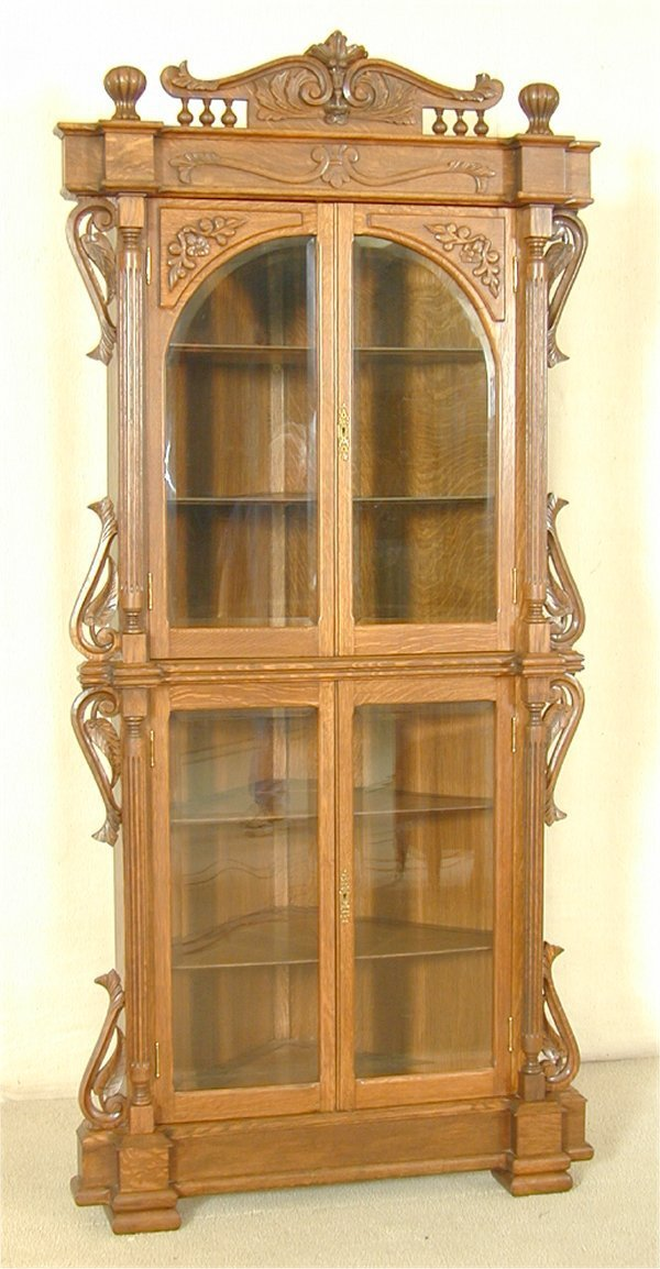 5385: HIGHLY CARVED OAK CORNER CUPBOARD W/FULL FLUTED P