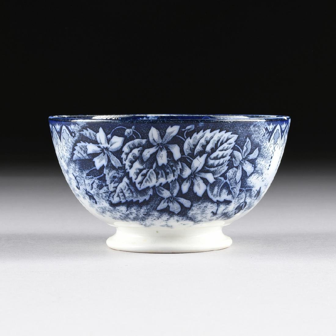 AN ANTIQUE KELLER & GUERIN BLUE AND WHITE DECORATED