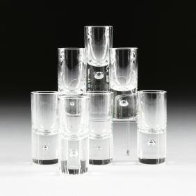 A SET OF SEVEN KOSTA BODA CLEAR CRYSTAL SHOT GLASSES