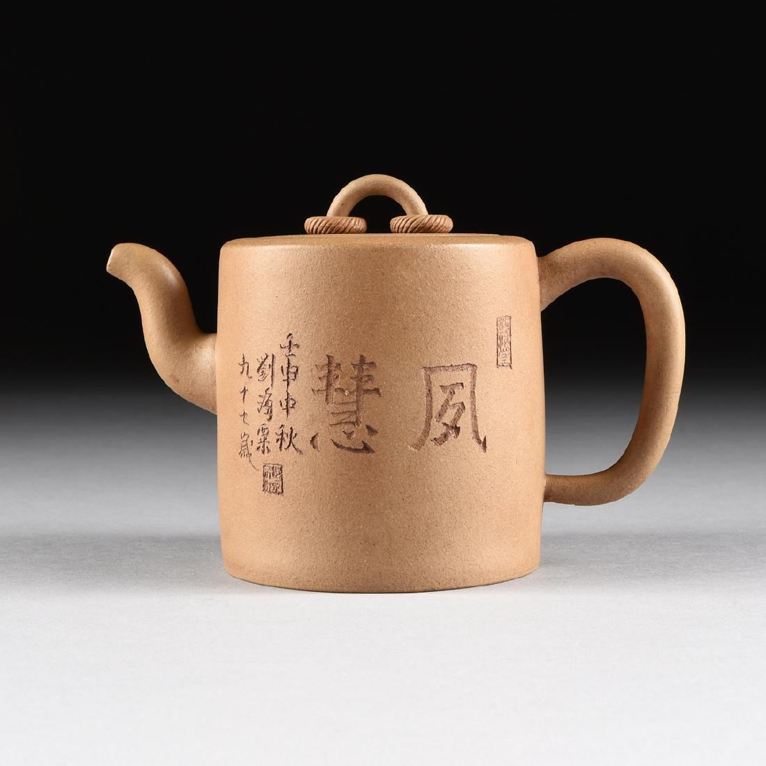A CHINESE TAN STONEWARE TEAPOT, YIXING PROVINCE, LATE - 7