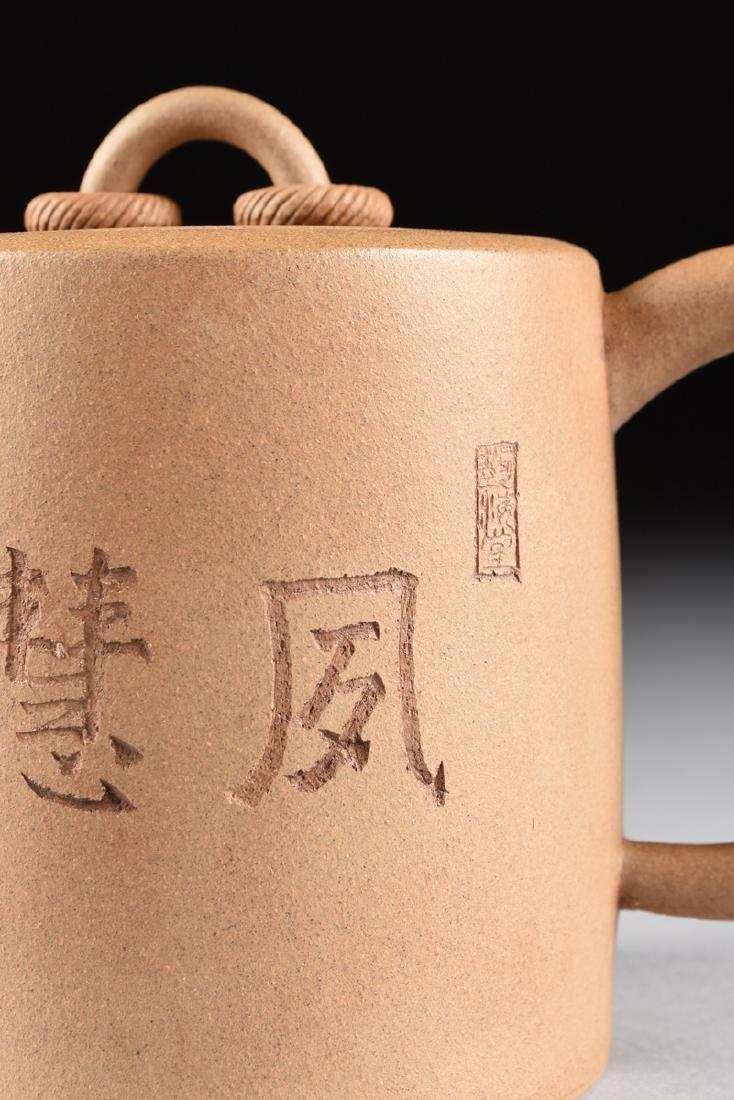 A CHINESE TAN STONEWARE TEAPOT, YIXING PROVINCE, LATE - 8