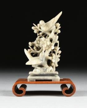 A CHINESE CARVED SOAPSTONE FIGURAL GROUP, 20TH CENTURY,