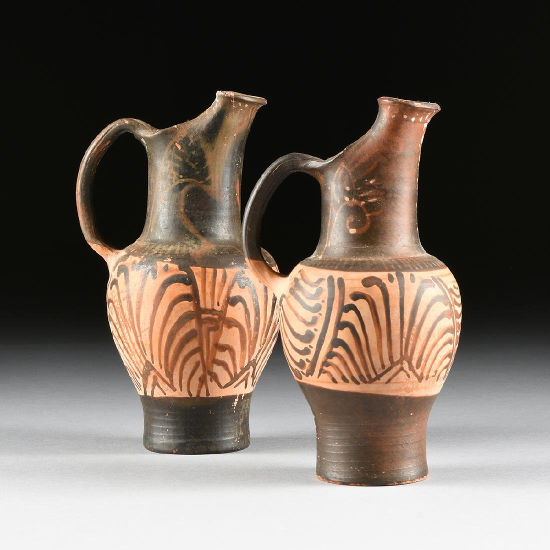 A PAIR OF ETRUSCAN STYLE BLACK FIGURE TREFOIL OINOCHOES