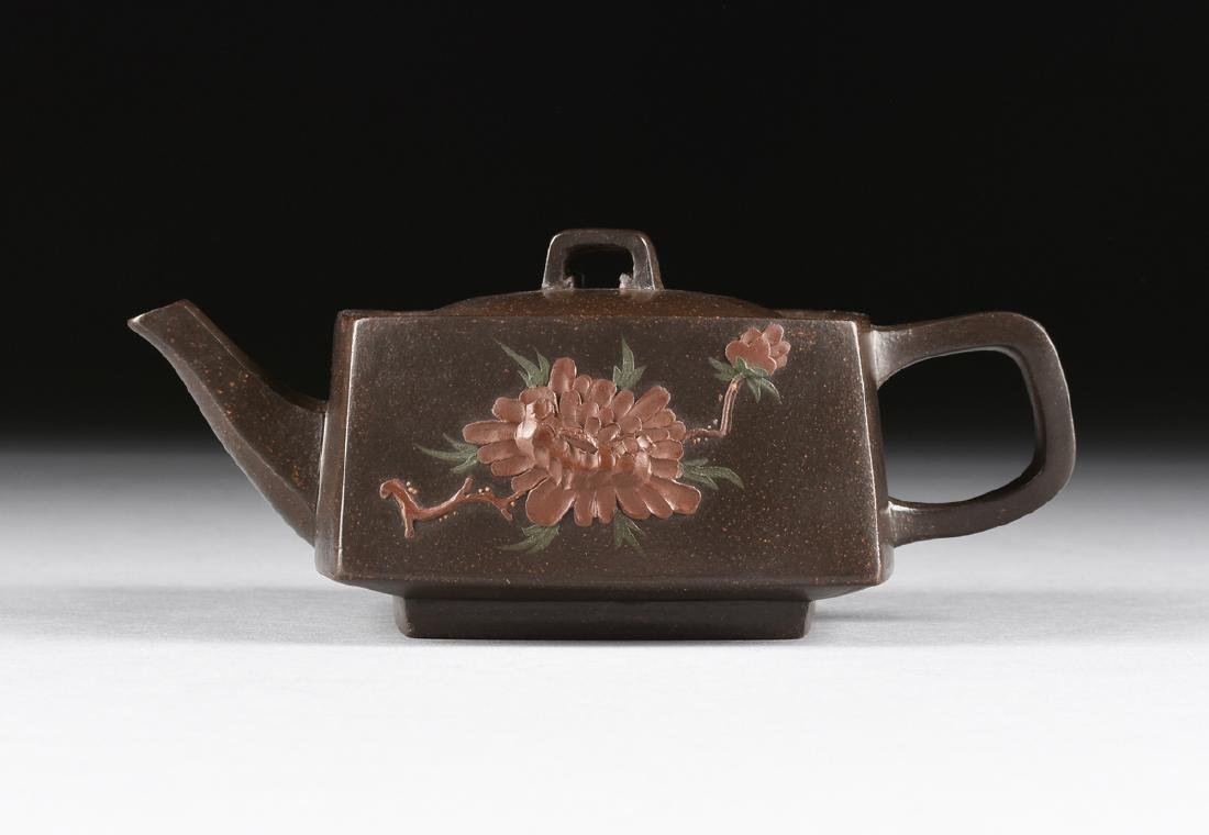 A CHINESE RED STONEWARE TEAPOT, YIXING PROVINCE, LATE